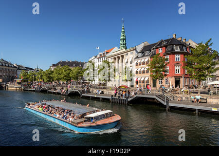 Tour boat with tourists in Copenhagen Canal, Copenhagen, Denmark - Stock Image
