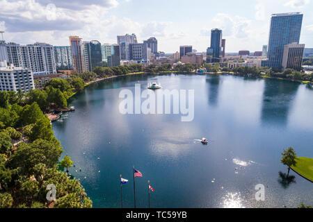 Orlando Florida Lake Eola Park downtown city skyline high rise office buildings residential condominium apartment aerial overhead bird's eye view abov - Stock Image
