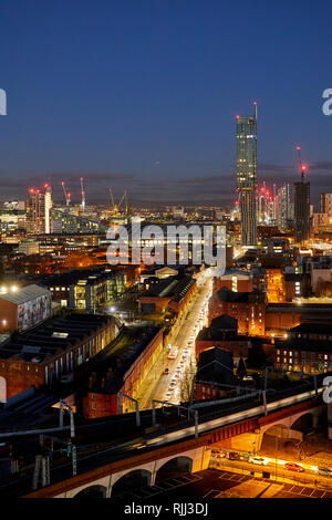 Manchester city centre skyline view across the rooftops from Salford from Wilburn Basin, showing   Beetham Tower looking down liverpool Road at Night  - Stock Image