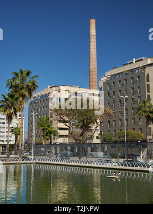 Monica´s Chimney (Chimenea Mónica - Chimenea de Los Guindos) from West park (Parque del oeste). Málaga, Andalusia, Spain. - Stock Image