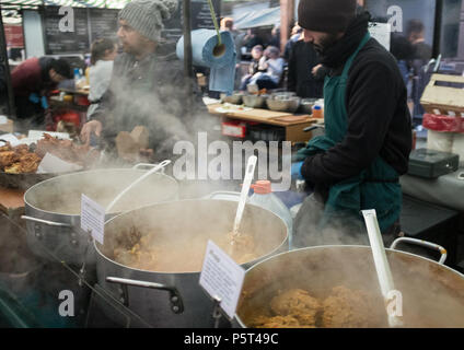 Delicious Steaming hot street food, Variety of Curries the weekly Broadway Street Market, Hackney, London, England, Europe. - Stock Image