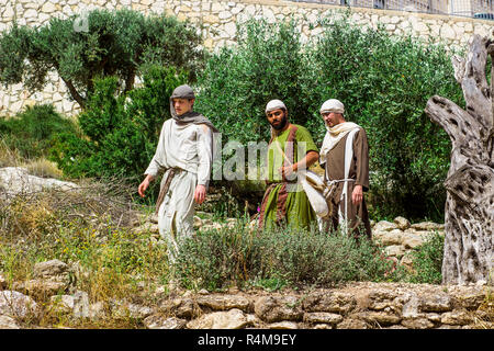 Young men in period costume in the open air museum of Nazareth Village Israel. This site provides an authentic look at the life and times of Jesus in  - Stock Image