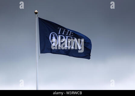 Portrush, Country Antrim, Northern Ireland. 17th July, 2019. The 148th Open Golf Championship, Royal Portrush Golf Club, Practice day; a large Open Championship flag flutters in the breeze near the first tee Credit: Action Plus Sports Images/Alamy Live News - Stock Image