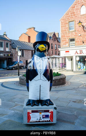 A Sculpture of a penguin wearing top hat and tales stands on the High Street in Kirriemuir, Scotland. - Stock Image
