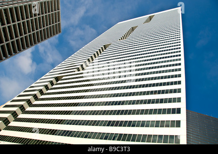 Towering white building skyscraper downtown Houston Texas tx skyline blue sky bs - Stock Image