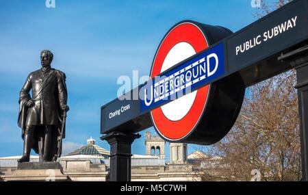 Charing Cross Underground tube station subway entrance, on Trafalgar Square, next to statue of Major General Sir - Stock Image