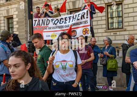 London, UK. 13th October 2018.   People at the rally in London to oppose racism  and fascism close to where the racist, Islamophobic DFLA were ending their march on Whitehall bringing together various groups to stand in solidarity with the communities the DFLA attacks. The event was organised by Stand Up To Racism and Unite Against Fascism. Peter Marshall/Alamy Live News - Stock Image