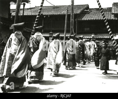 Procession of Buddhist Lama Priests through the streets of Kyoto, Japan. - Stock Image
