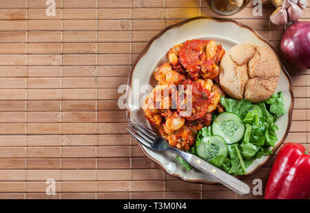 Baked giant beans with tomato sauce. Greek traditional food - Stock Image