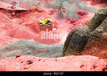 Excavating volcanic Scorai rock from the Seydisholar cone for road building material, near Selfoss, Iceland - Stock Image