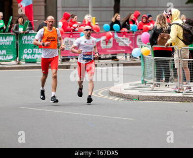 Marcin Grabinski with his guide runner, competing in the 2019 London Marathon. Marcin went on to finish 12th in the Men's Elite,  World Para  T11/12 Category, in a time of 02:52:54 - Stock Image