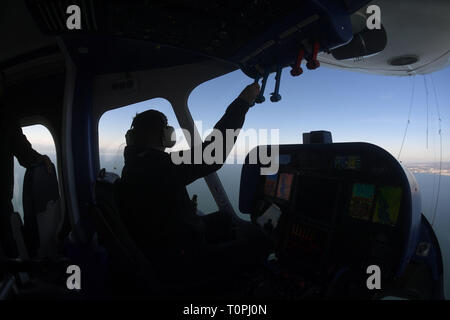 Friedrichshafen, Germany. 21st Mar, 2019. Zeppelin pilot Lars Pentzek of the Zeppelin NT (New Technology) flies over Lake Constance. The first Zeppelin passenger flight of the 2019 season took place today at Lake Constance in beautiful weather. Credit: Felix Hörhager/dpa/Alamy Live News - Stock Image