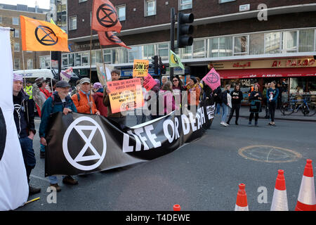 Extinction rebellion climate protesters block Egdware Road in central London. - Stock Image