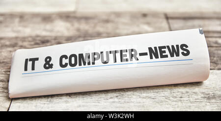 IT & Computer News on the front page of a newspaper - Stock Image