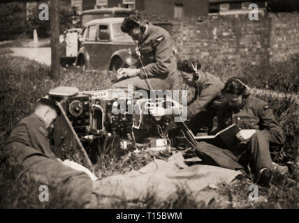 World War 2  Flight crews training in the use of field wireless equipment to get an understanding of the importance of wireless communications and connected services like Radar and Navigation and the role they plated during the conflicts. - Stock Image