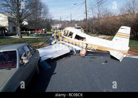 A plane crash on a residential street - Stock Image