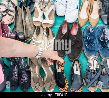 Second hand shoes on street market in Spain - Stock Image