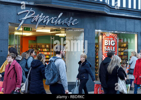 Shoppers walking past the Chester branch of Paperchase with sale signs in the window - Stock Image