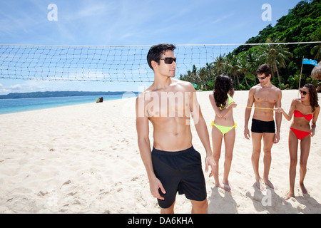 Friends on a beach. - Stock Image