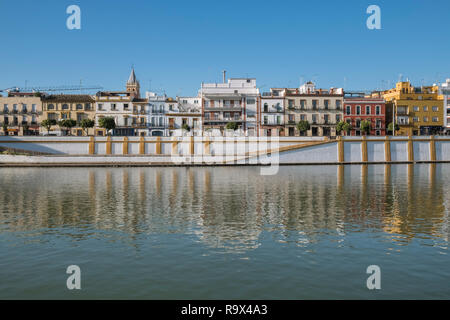 Colourful homes with elevated views over the Guadalquivir river, Seville, Spain. - Stock Image