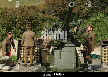 Dover Castle, Kent, UK - September  30 2018:  Guides prepare a 3inch 20cwt AA gun ahead of a   firing demonstrate of the military defence used in 1914 fro the White Cliffs of Dover.. Dover in Kent is a major port for ferries to Calais, France. Credit: David Mbiyuedieval Dover Castle overlooks the town from the iconic White Cliffs. Dover in Kent is a major port for ferries to Calais, France. Credit: David Mbiyu - Stock Image