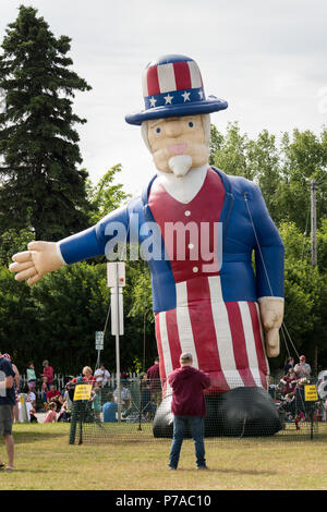 Anchorage, Alaska. 4th July, 2018. A giant Uncle Sam inflatable decorates Delaney Park during the annual Independence Day parade July 4, 2018 in Anchorage, Alaska. Credit: Planetpix/Alamy Live News - Stock Image