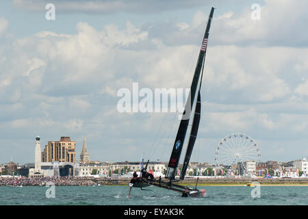 Portsmouth, UK. 25th July 2015. Oracle Team USA fly a hull as their AC45f heads towards Portsmouth seafront where - Stock Image