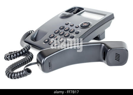 Picture of a business landline telephone with the receiver off the hook laying in front of the phone - Stock Image