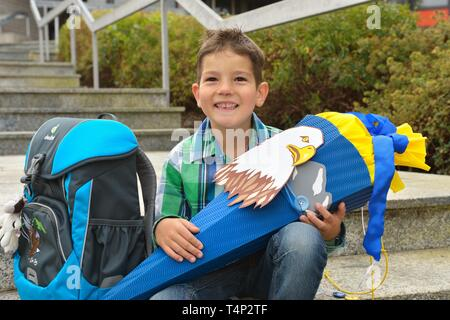 Boy, 6 years, first day at school with school bag and school cone, Portrait, Germany - Stock Image