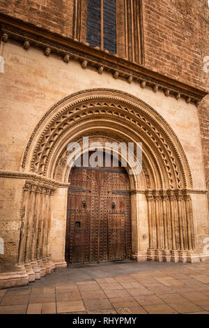 Romanesque style portal doorway to the Valencia Cathedral from Plaza de l'Almoina Spain. - Stock Image