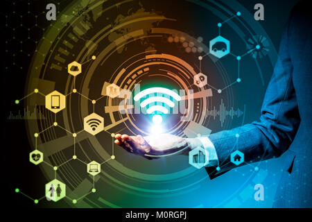 business woman holds symbolic icon, technological abstract, Internet of Things - Stock Image