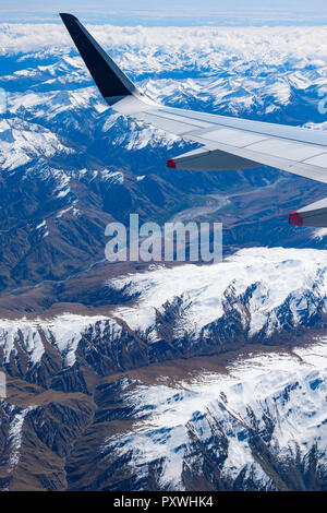 New Zealand's South Island, aerial view from commercial airplane inlcuding segement of aircraft's wing - Stock Image