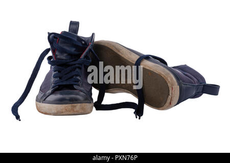 Old worn blue boy shoes isolated on white background. - Stock Image