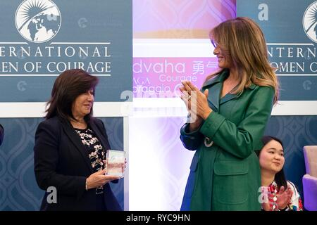 U.S First Lady Melania Trump, right, presents Flor de Maria Vega Zapata of Peru with the 2019 International Women of Courage awards at the State Department March 7, 2019 in Washington, DC. - Stock Image