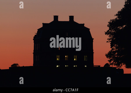 The Hermitage, at dusk, Hunting Lodge in Royal Deer Park Klampenborg, Copenhagen, Sjaelland, Denmark - Stock Image