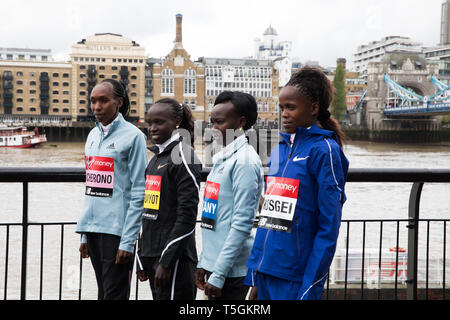 London, UK. 25th Apr, 2019. The London Marathon Elite Women's Photocall takes place outside the Tower Hotel with Tower Bridge in the background ahead of the Marathon on Sunday. Taking part are: Gladys Cherono(Ken), Vivian Cheruiyot(Ken), Mary Keitany(Ken) and Brigid Kosgei(Ken). Credit: Keith Larby/Alamy Live News - Stock Image