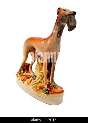 Staffordshire pottery standing greyhound with hare in it's mouth.  This are probably a reproduction. - Stock Image