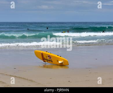 RNLI Rescue Surfboard on Sennen Cove Beach,Cornwall,England,UK - Stock Image