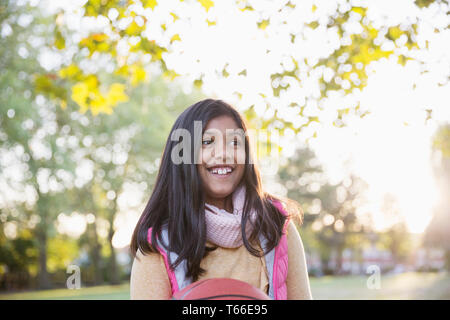Smiling girl in autumn park - Stock Image