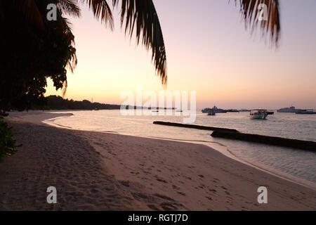Maldives beach sunset - sunset at the beach, Kuramathi island, Rasdhoo atoll, the Maldives Asia - Stock Image