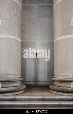 Greek revival architecture artistic standing light sconce or fixture between two massive concrete or marble columns in Montgomery Alabama, USA. - Stock Image