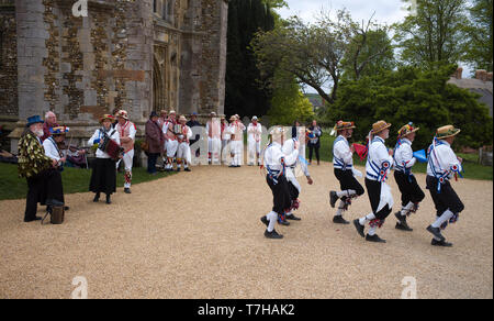 Thaxted Essex England UK. Traditional Morris Dancing on Bank Holiday Monday in the church yard car park. 6 May 2019 Thaxted Morris side in red and whi - Stock Image