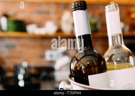 Bottles of Wine in bar with copy space. - Stock Image