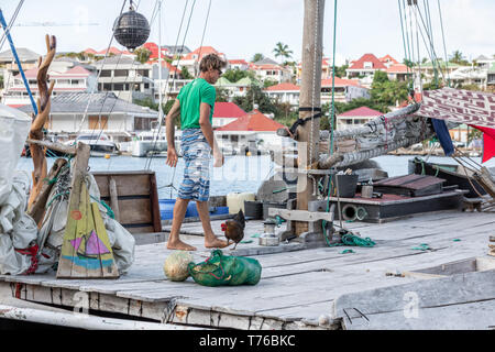 Man on a sail boat in Gustavia, St Barts - Stock Image