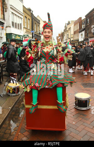 Rochester, Kent, UK. 1st December 2018: A participant of the Main parade entertains on Rochester High Street. Hundreds of people attended the Dickensian Festival in Rochester on 1 December 2018. The festival's main parade has participants in Victorian period costume from the Dickensian age. The town and area was the setting of many of Charles Dickens novels and is the setting to two annual festivals in his honor. Photos: David Mbiyu/ Alamy Live News - Stock Image