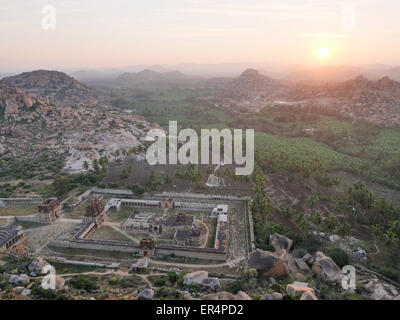 Temple relics in Hampi at sunrise India - Stock Image