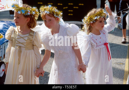South Miami Florida Santa's Parade of the Elves girls dressed as angels community Christmas - Stock Image