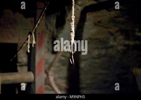 An instrument of torture on display at the Medieval Crime Museum in Rothenburg ob der Tauber, Germany. - Stock Image
