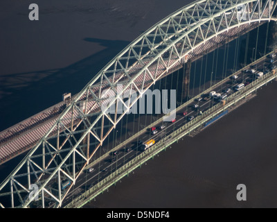 Warrington Bridge, road and railway bridges over Mersey from the air - Stock Image