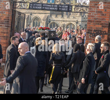 Braintree, Essex, UK. 29th Mar 2019.  Funeral of Prodigy frontman Keith Flint at St Mary's Church in Bocking attended by hundreds of his fans/ Mourners enter the church following the coffin Credit: Ian Davidson/Alamy Live News - Stock Image